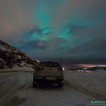Aurore Boréale cachée derrière les nuages à l'ouest d'Alta, Norvège
